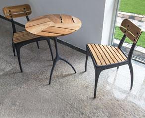 New Talon Zinc indoor / outdoor round bistro table with teak slats.